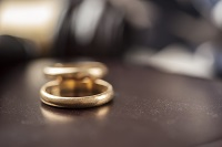 Wedding rings on a table during divorce